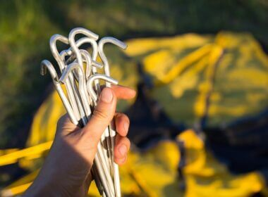 Aluminum stakes in a man's hand