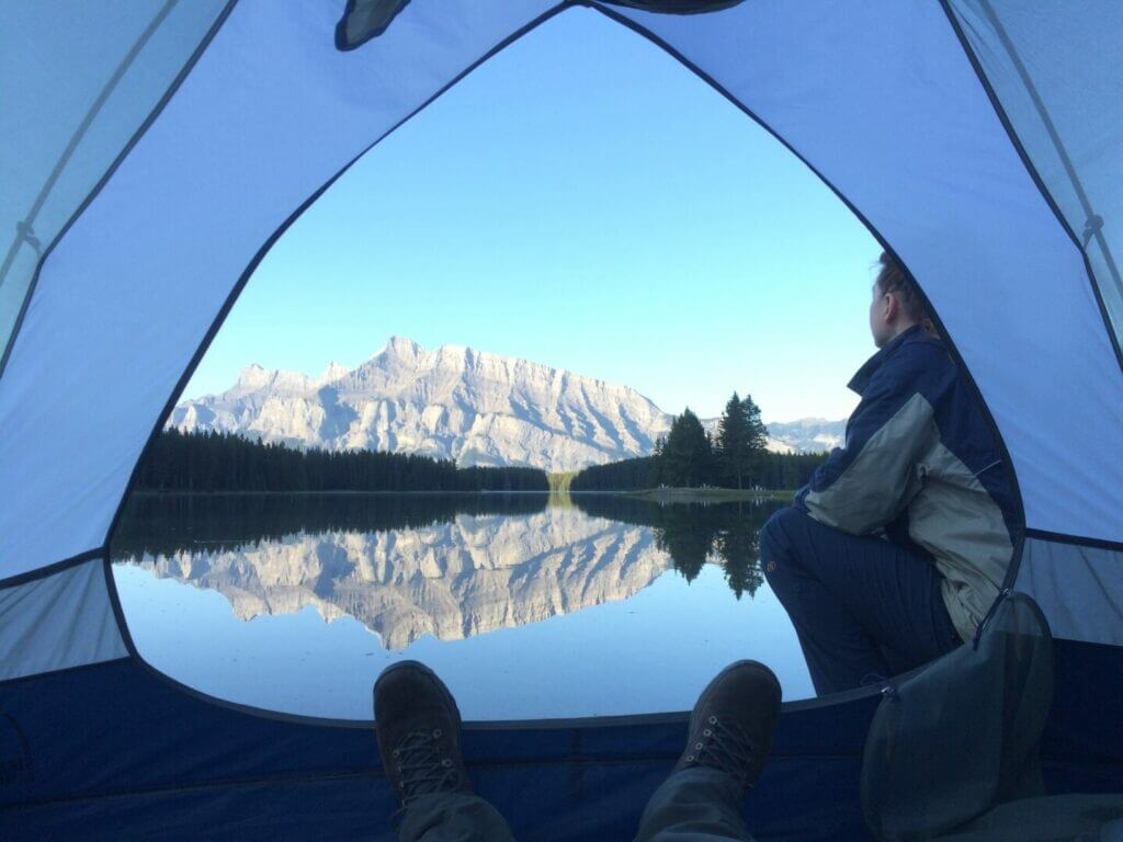 the view from inside a tent looking out at Minnewanka in Banff National Park