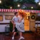 couple dancing outside their RV listening to the RV stereo system