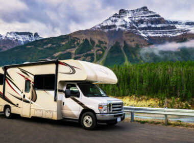 An RV is parked in front of a gorgeous bucket list mountain destination.