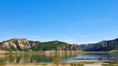 A blue sky day at Lake Piru is not uncommon with rolling hills along the shoreline.