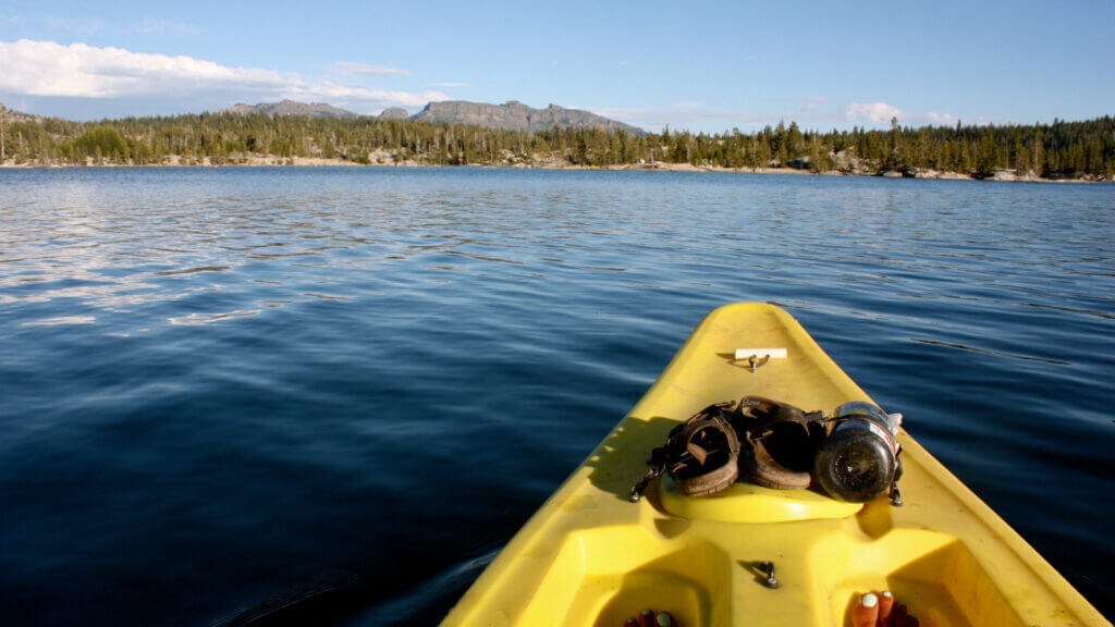 A kayak sits on the still waters of Causey Reservoir in Utah, where not motorized boats are allowed.