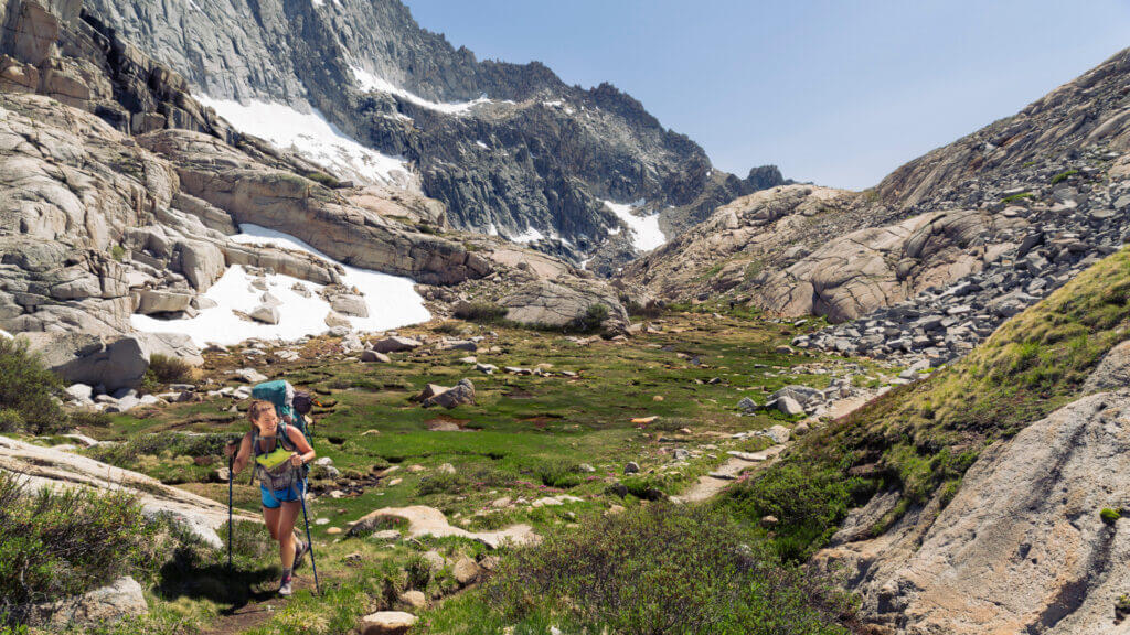 A woman long hikes into the High Sierra Mountains above Mammoth Lakes.