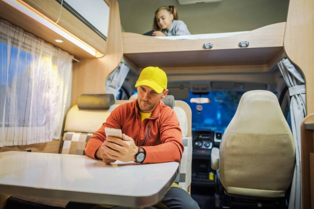 Family enjoying internet thanks to an RV cell phone booster.