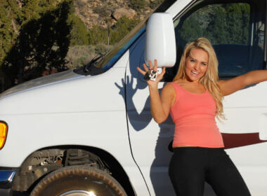 A woman excitedly holds the keys to her new RV but is she aware of the RV ownership costs she has ahead of her?