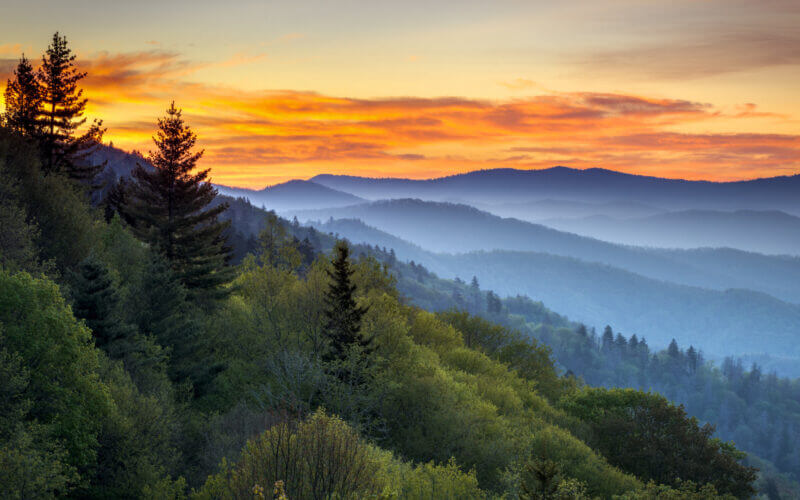 A sunset over the smoky mountains is a gorgeous view you can enjoy on your RV trip there!