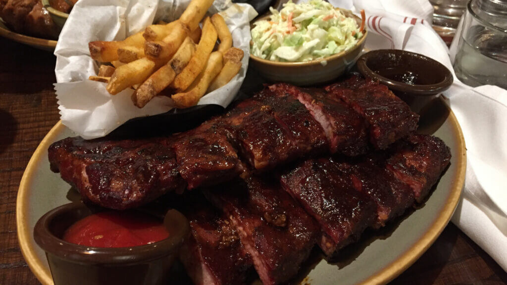 You can't leave Kansas City without trying some BBQ like this plate of ribs and fries and coleslaw.