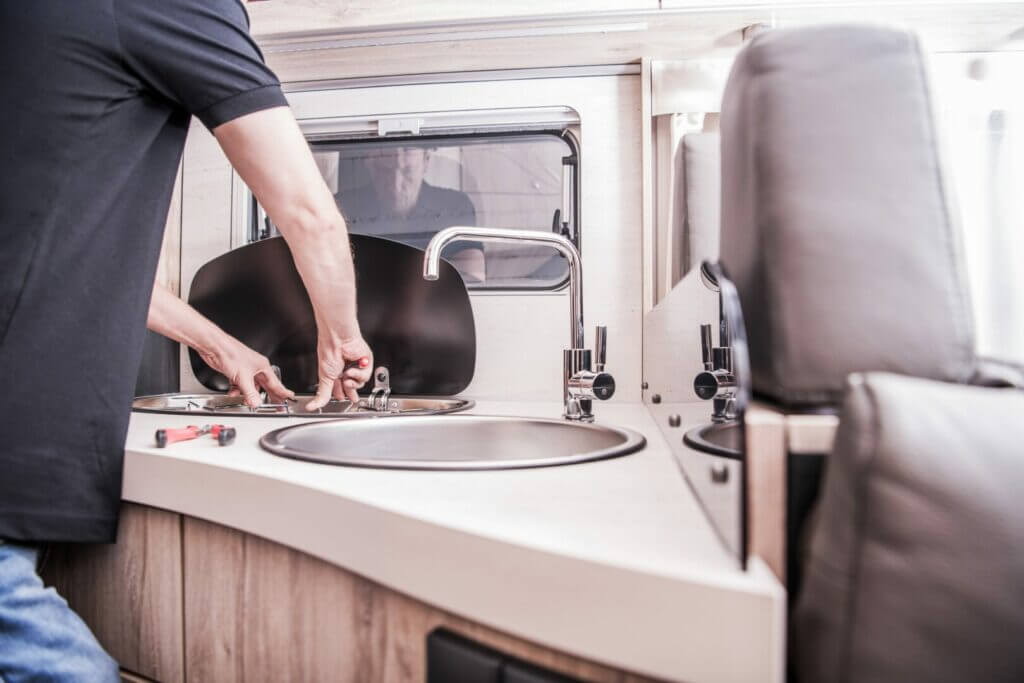 A man performing an RV inspection.