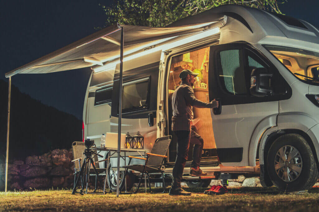 A man preparing to go to sleep in his camper.