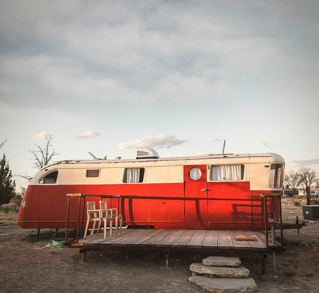 An old red RV that is the product of RV renovation regrets.