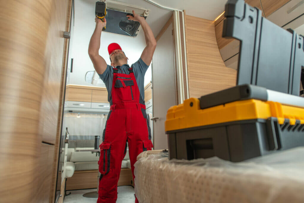 A professional repairman working to prevent RV renovation regrets.