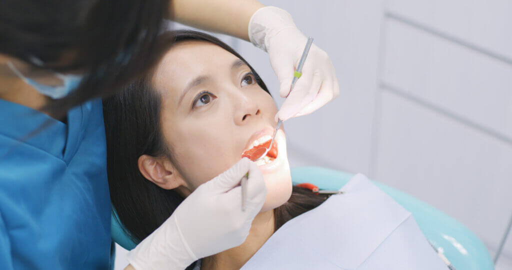 A woman receiving dental work in Mexico.