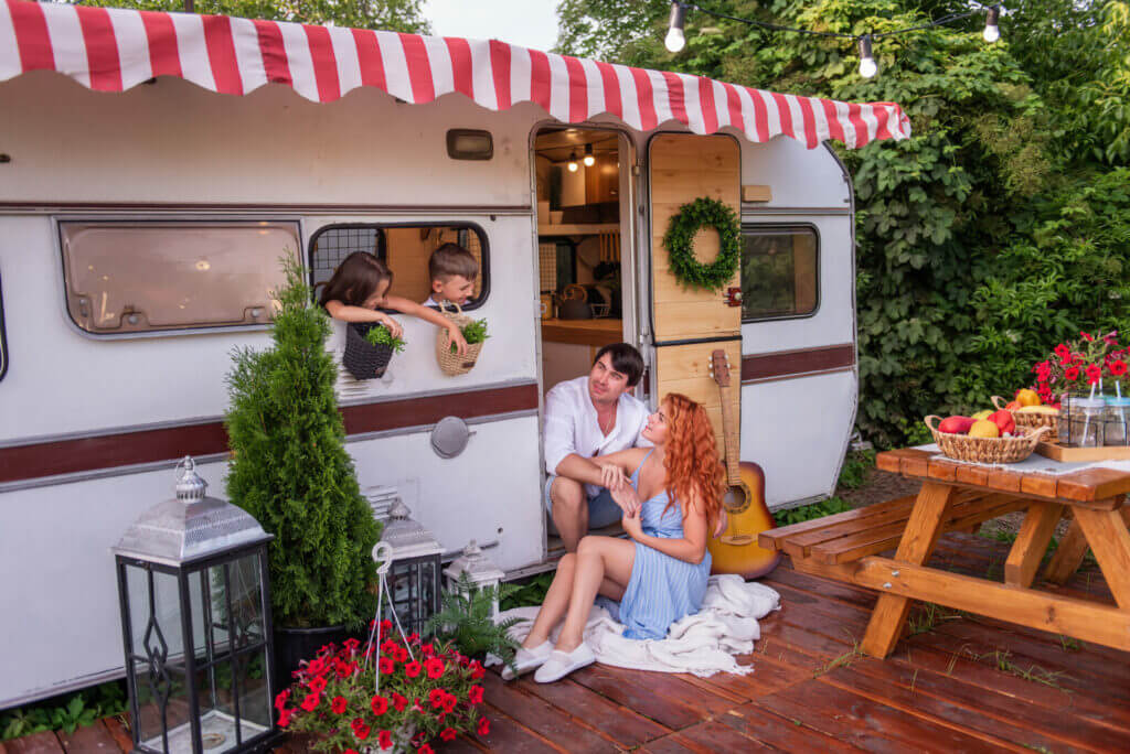 A family enjoying their time camping in a travel trailer.