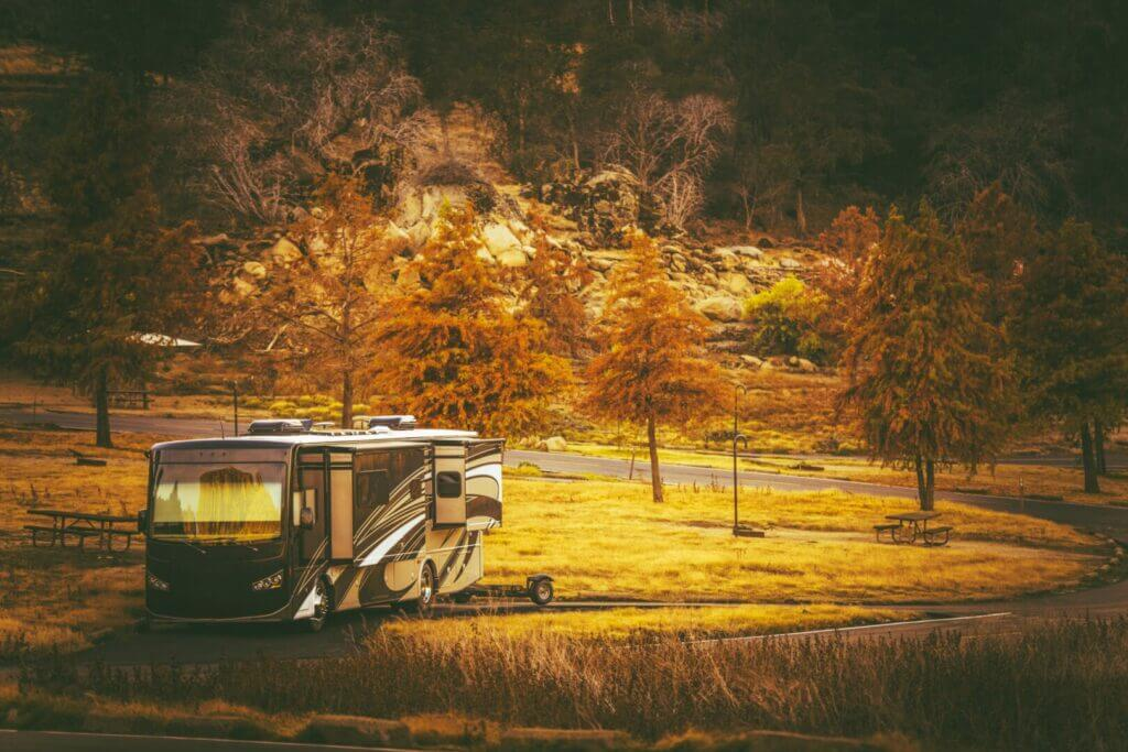 Class A motorhome camping in a forest.