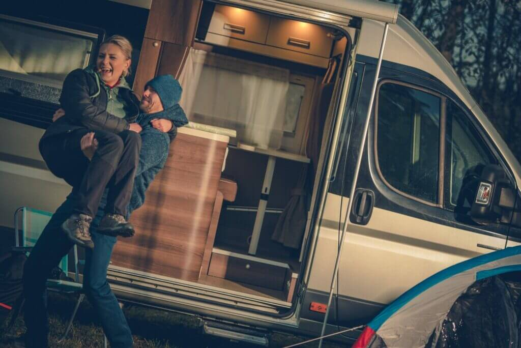 A woman and her partner enjoying their time RVing.