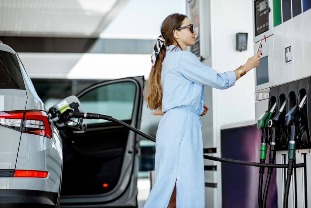 Woman using her EFS Fuel Card to get gasoline.