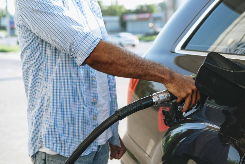 Man putting fuel in his car with a EFS Fuel Card.