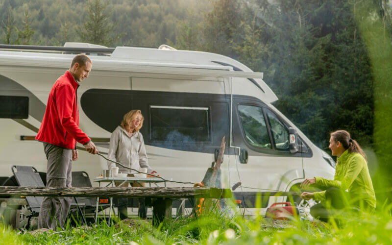 Family camping with their Class C RV.
