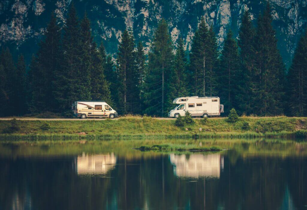 Two RVs Boondocking beside a lake.