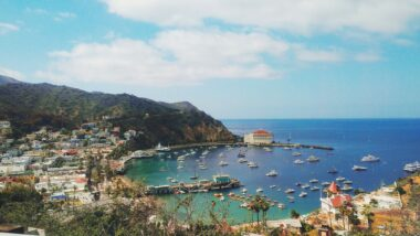 Catalina Island from above with houses on the mountain and boats in the water