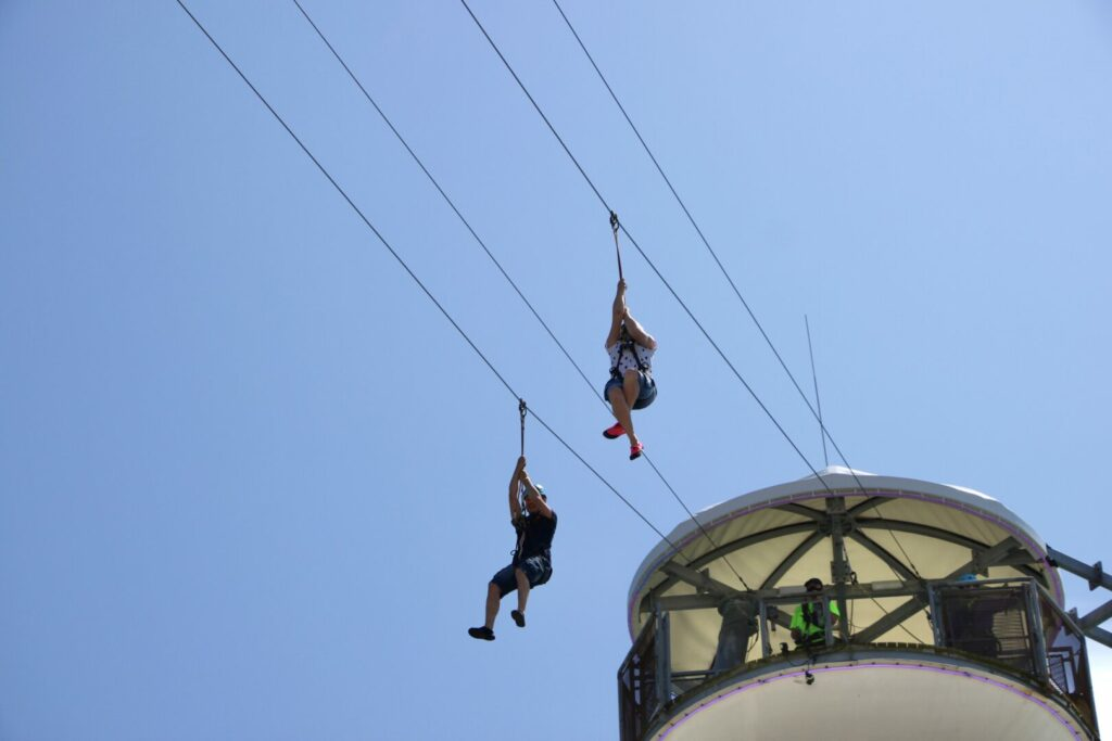 Two people zip lining off a platform, one of the best things to do in Catalina Island