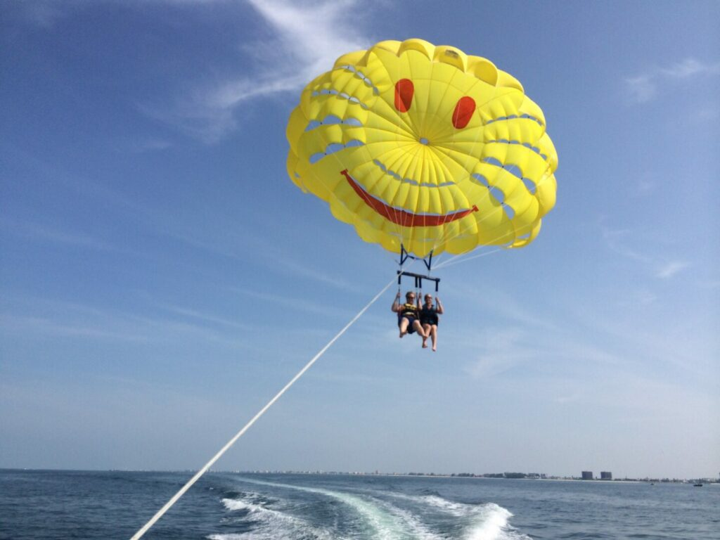 Two people parasailing over the water - one of the best things to do in Catalina Island