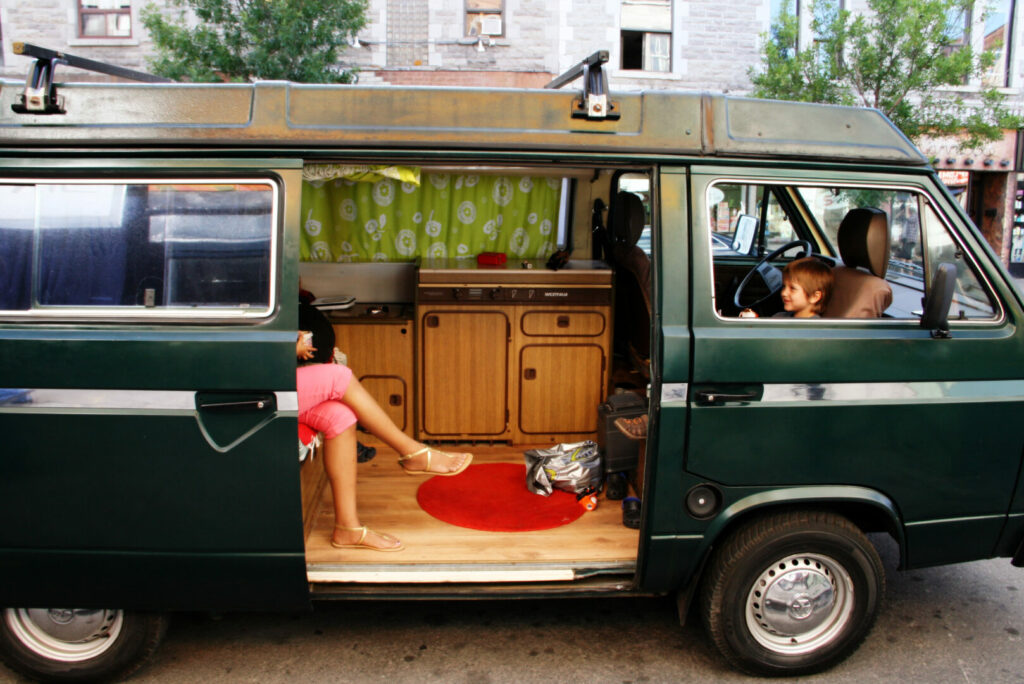 Family preparing for vacation in their camper.
