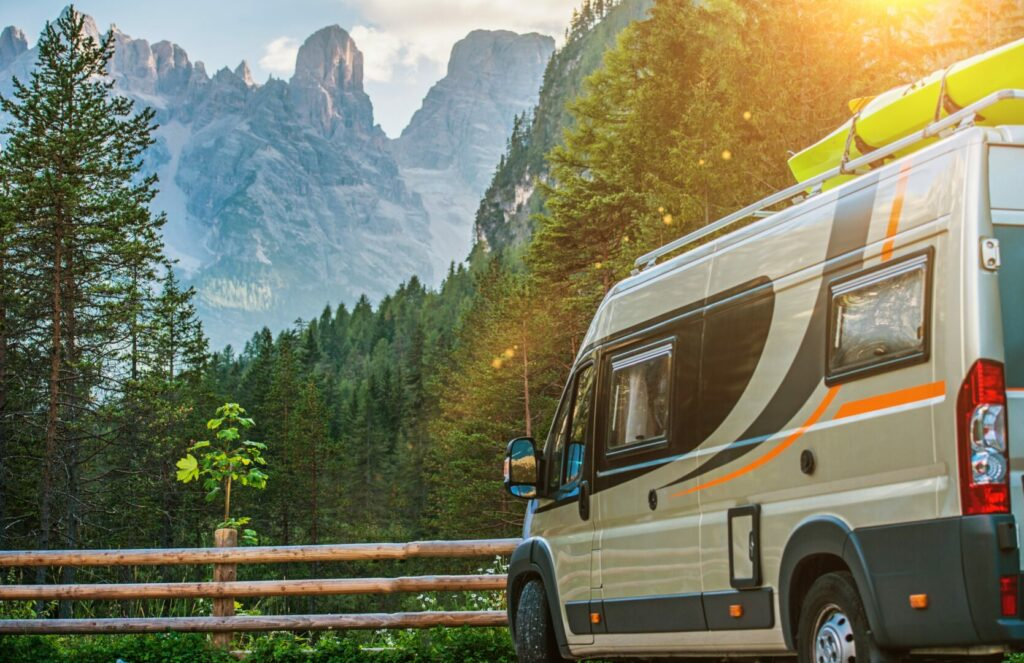 Class B motorhome parked overlooking a forest in a national park.