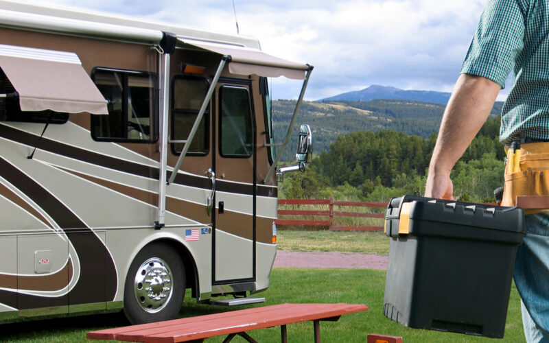man with his RV tool kit about to work on his RV