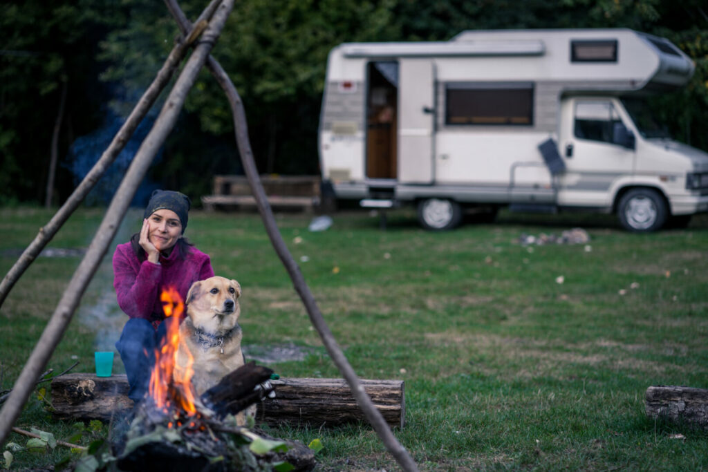 Woman with her dog following camping rules.