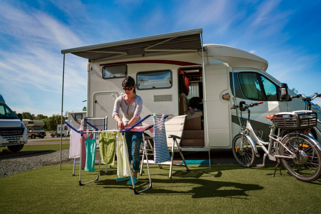 Woman doing her laundry at a campsite following camping rules.