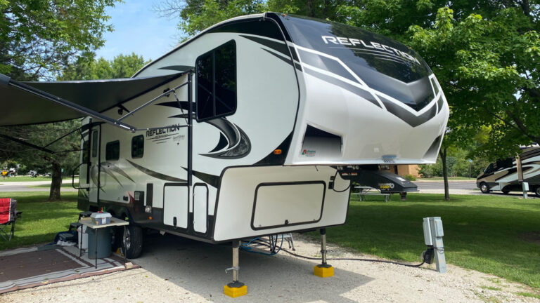 A Grand Design Reflection fifth wheel is camped out and has a spacious floorplan perfect for full time living.