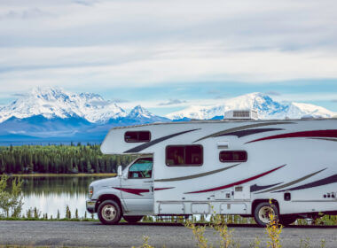 An RV is parked and ready to camp near Mammoth Lakes with the mountains looming in the background.