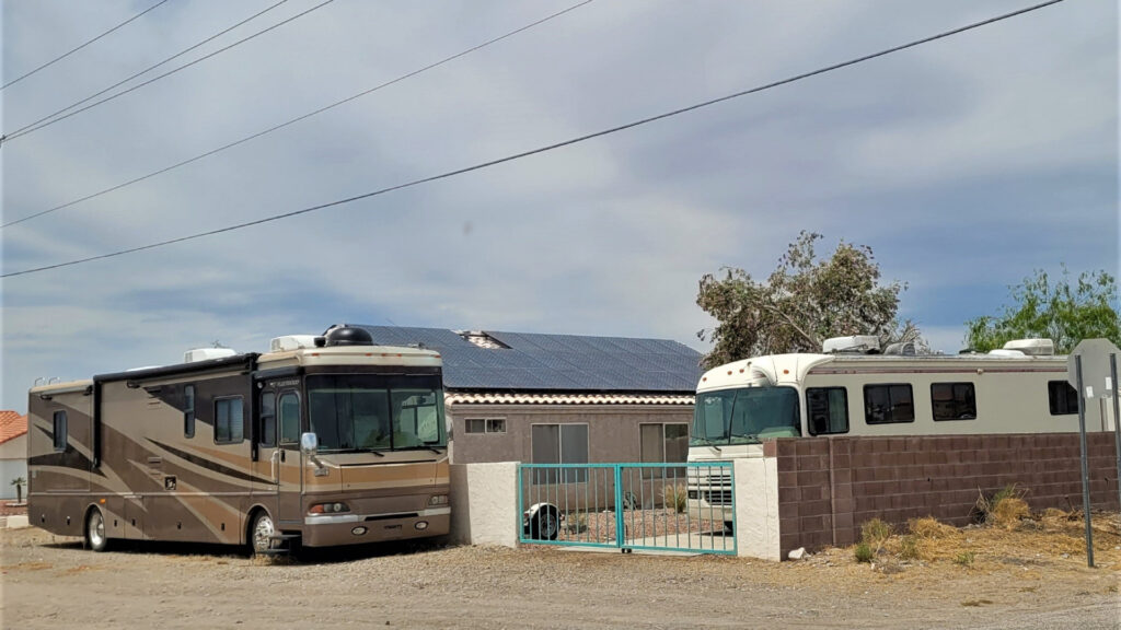 Two RVs take advantage of moochdocking in the driveway of a person's house.
