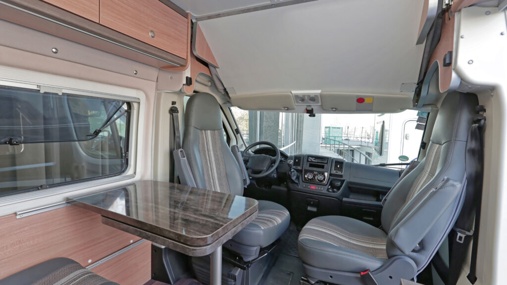 The inside of an RV that looks clean and in good shape.
