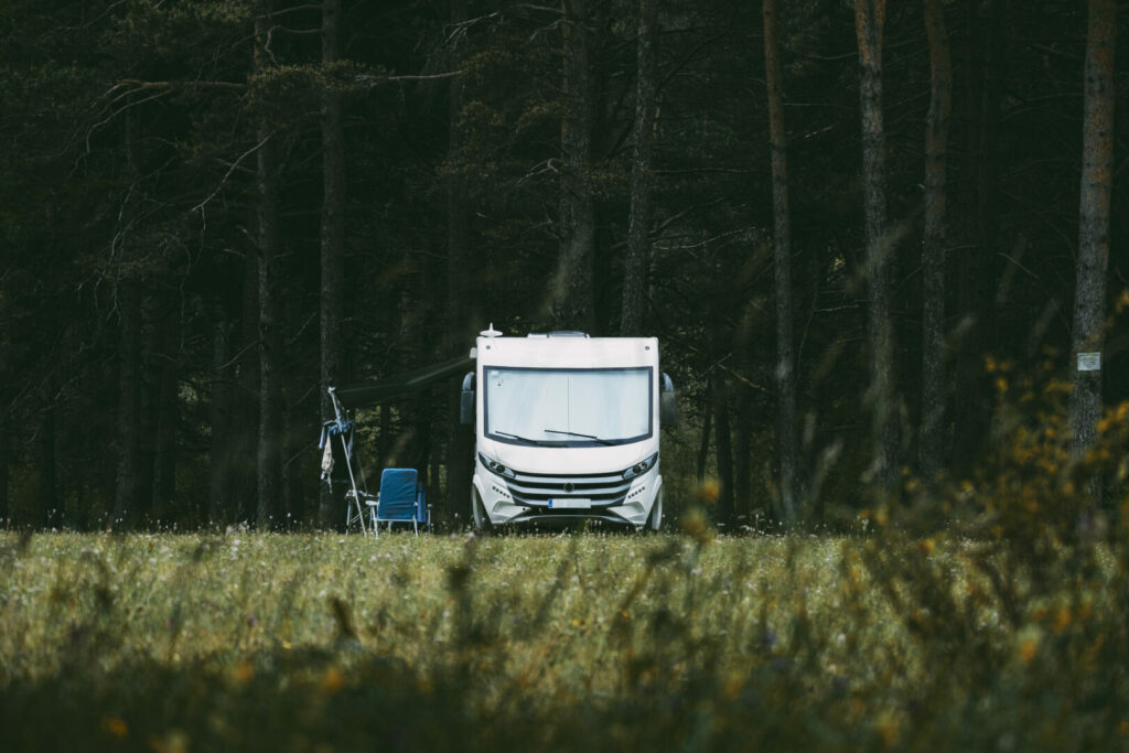 Camper parked along the forest tree line in Shawnee National Forest.