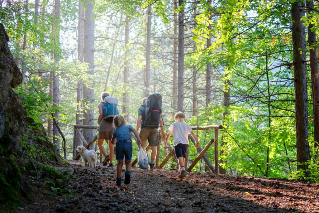 Family walking down a trail in Ocala National Forest.