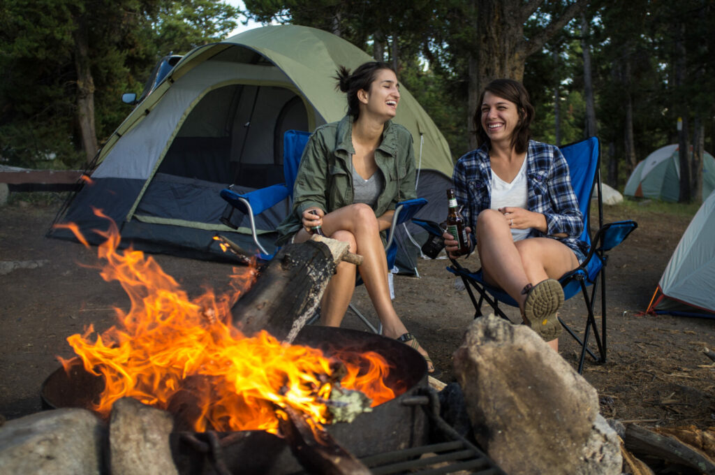 Friends on vacation enjoying their time together beside the campfire.