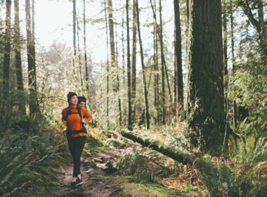 Woman walking through National Park forest.