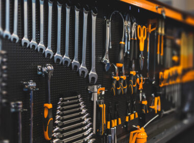 An organized wall of tools to keep things clean in an RV basement.