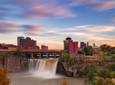 A colorful sunset over High Falls and the Rochester NY skyline.