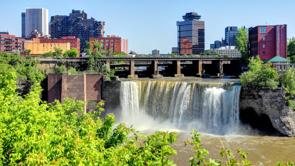 High Falls in Rochester, NY flow along the city skyline.