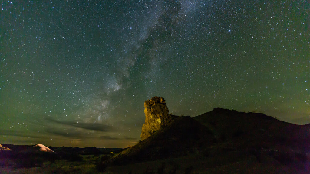 The milky way galaxy and many more stars are visible above the wide open Texas night sky.