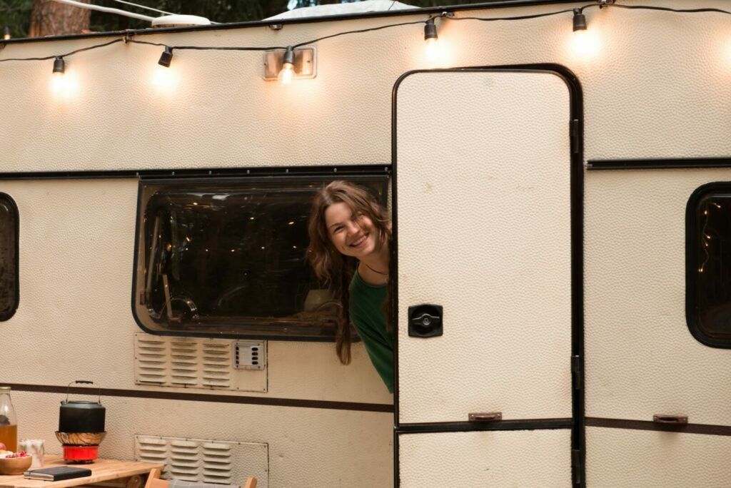 Harvest host regrets include not being to use hook-ups. Happy woman with self sufficient RV.