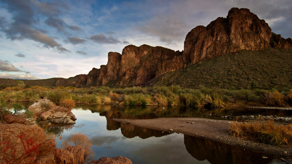 Saguaro Lake is a beautiful water feature within Tonto National Forest with mountains in the background.