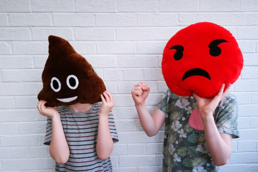 Angry emoji pillows showing how people feel about Facebook.