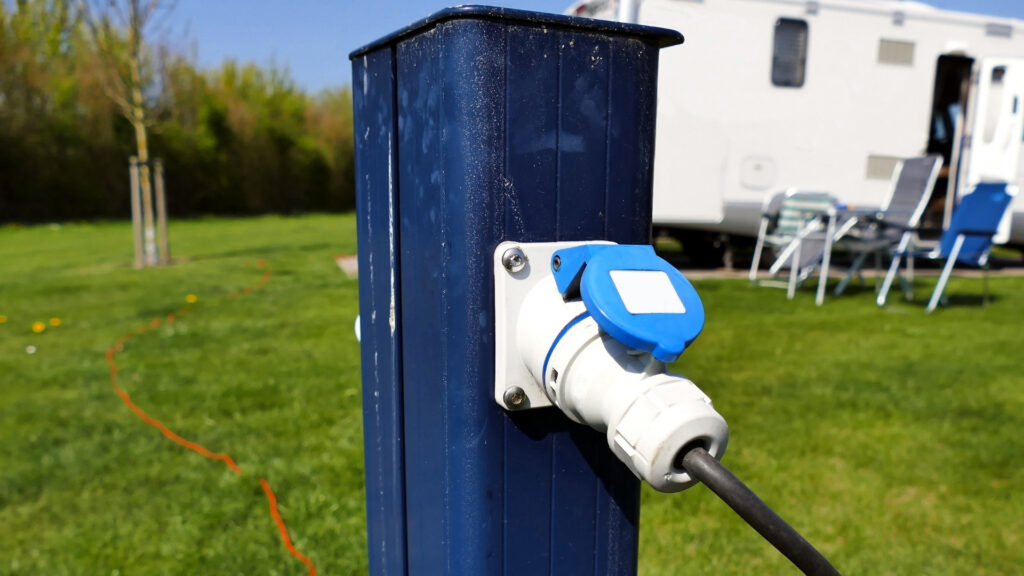 A power station at a campground provides steady shore power, so no relying on generators or solar panels.