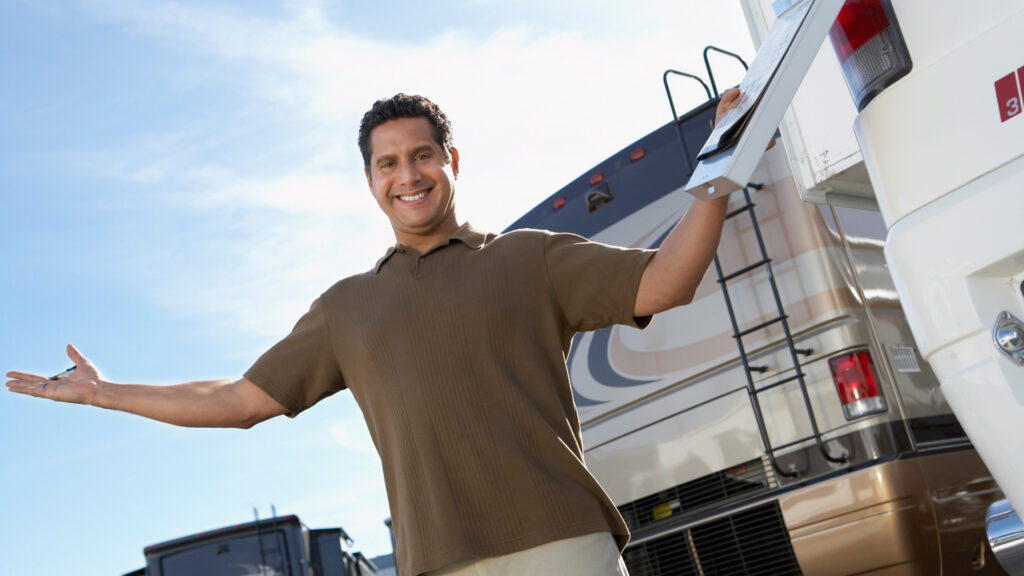 A man looks happy buying a renovated rv.