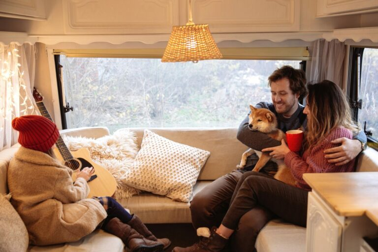 An RV family stays warm on a winter day inside their RV.