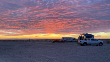 A few RVs enjoy a beautiful sunset and privacy by free camping in Arizona.